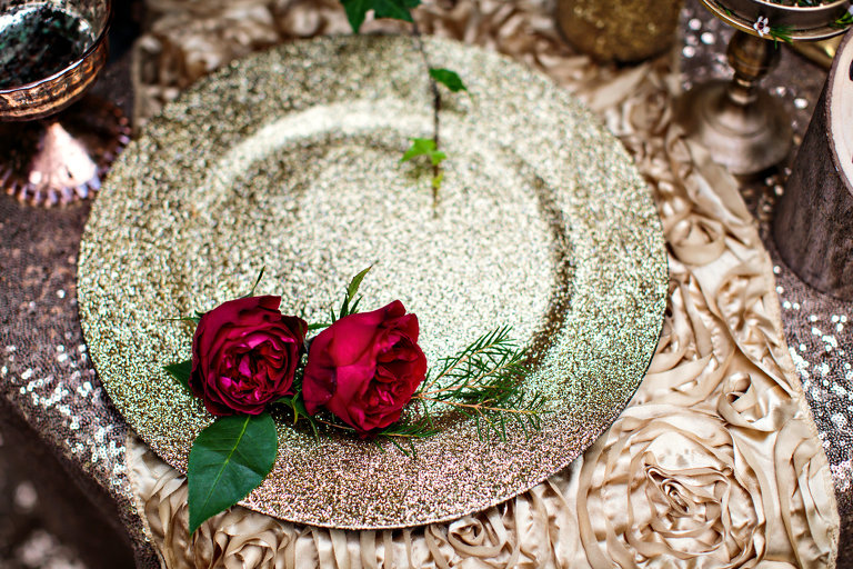 lovely wedding details roses on a glittering gold plate